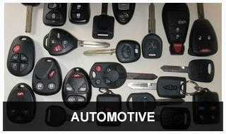 Image of a variety of transponder head keys, remotes and key fobs